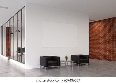 Office waiting area with white and brick walls. There are two square armchairs near a coffee table, a poster above it and a room with glass walls in behind it. 3d rendering, mock up