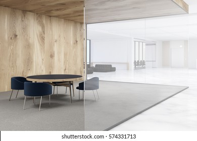 Office with white and wooden walls. Waiting area with a round table surrounded by armchairs. 3d rendering. Mock up.