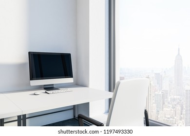 Office workplace interior with white walls, loft windows, white table with a computer on it and white chair. 3d rendering mock up