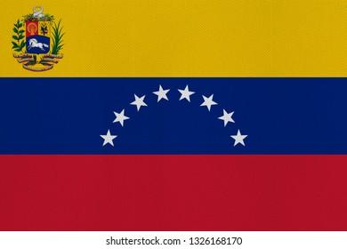 The official Venezuelan flag on the fabric. flag of the Bolivarian Republic of Venezuela.