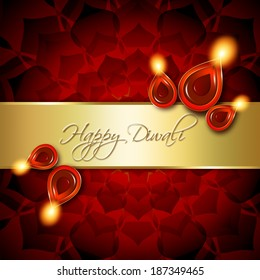 oil lamps with diwali greetings over dark red background