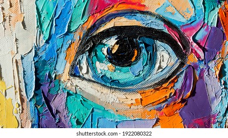 Oil portrait painting in multicolored tones. Abstract picture of a beautiful girl. Conceptual closeup of an oil painting and palette knife on canvas.