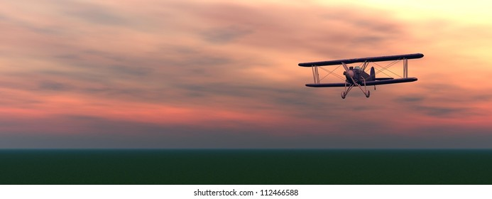 Old biplan flyinig upon the ground by colorful cloudy sunset