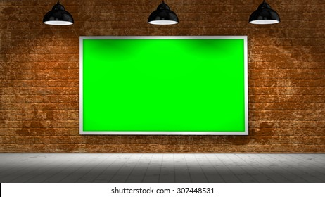 old brick wall and green screen picture frame illuminated with spotlights