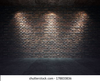 An old brick wall illuminated by three spot lights