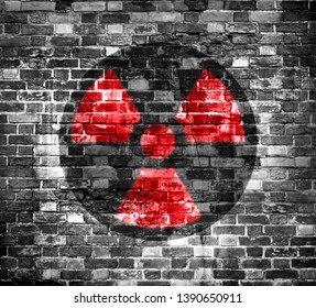Old brick wall with radiation warning symbol painted on it. 3D rendering or Illustration . Background or backdrop.