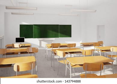 Old classroom with modern computer and green board