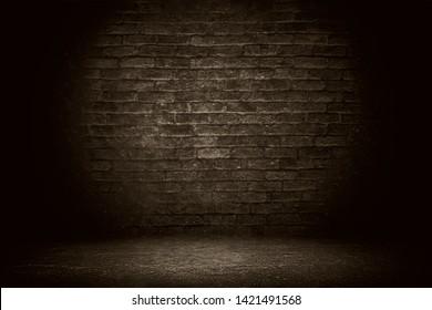 Old grunge brick wall background. Dark black brick wall texture.
