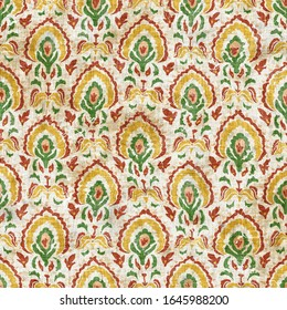 Old indian arabesque damask seamless pattern. Ornate spice color cracked aged wallpaper. Middle eastern style weathered painted background. Vintage ethnic decorative floral medallion all over print