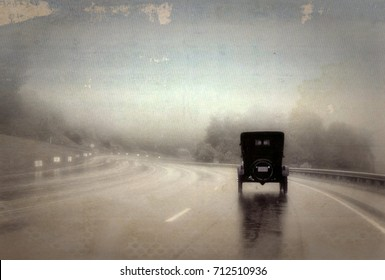 Old Jalopy Driving Down a Wet Highway