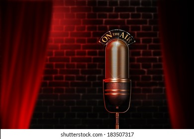 Old mic on air behind a curtain with red lights and wall on the background