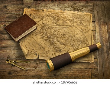 Old nautical map with telescope and logbook, navigation concept