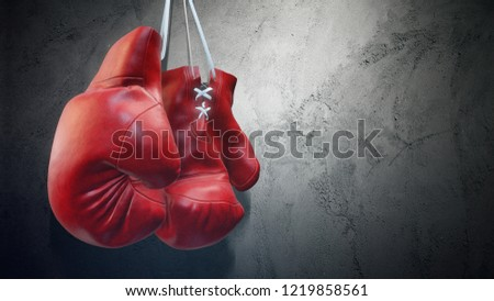 Old red boxing gloves