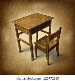 Old school desk symbol of education and learning in simpler times as a bi gone old fashioned era with vintage wooden student furniture on a dirty background.