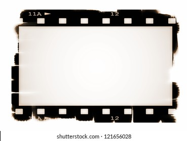 Old sepia blank film strip isolated on white