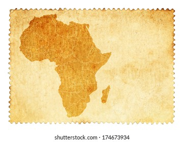 Old stain mark of an Africa continent map on a vintage brown postage stamp.