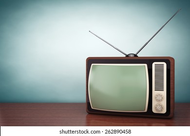 Old Style Photo. Classic vintage TV on the table