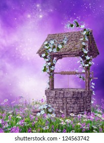 Old wishing well on a colorful meadow with flowers