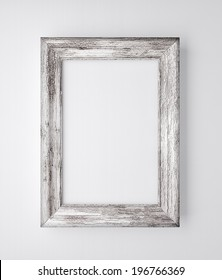 old wooden frame on the white wall