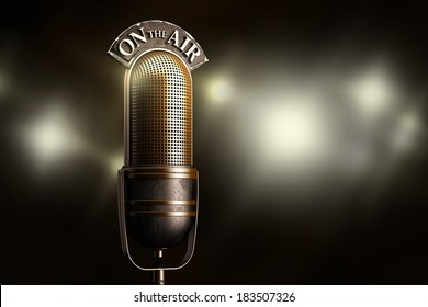 On the air with a golden vintage microphone and flash on the background