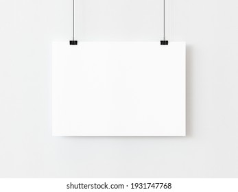 One blank horizontal rectangle poster template hanging on thread with paper clips on white background. 3D illustration