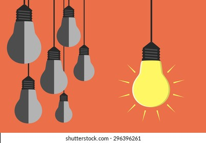 One glowing light bulb hanging beside many gray dull ones. Innovation, motivation, insight, inspiration concept