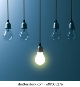 One hanging light bulb glowing different and standing out from unlit incandescent bulbs with reflection on dark cyan background , leadership and different business creative idea concept. 3D rendering.