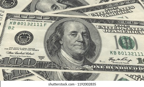 One hundred dollars banknote pile and portrait Benjamin Franklin on USA money banknote as background