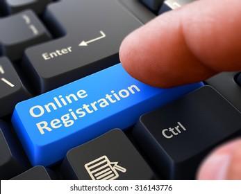 Online Registration - Written on Blue Keyboard Key. Male Hand Presses Button on Black PC Keyboard. Closeup View. Blurred Background.