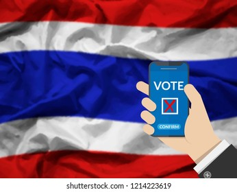 online vote , poll, exit poll for Thailand general election concept. hand holding phone and confirm vote via mobile phone casting a ballot at elections during voting on canvas Thailand flag background