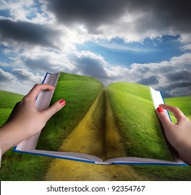 open book in hands and landscape