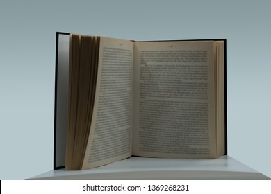 open book standing on the table in front of a blue and white background