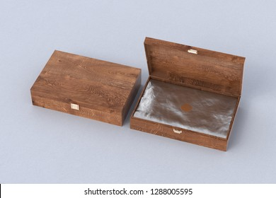Open and closed dark wooden long boxes or caskets with wrapping foil on white background. 3d illustration
