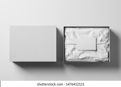Open and closed white realistic cardboard box with brown paper and a business card on a light background. Business gift concept. Mock up. Top view. 3d rendering