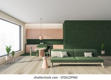Open space home interior with green sofa on parquet floor. Kitchen set, dining table with chairs, city view on skyscrapers, 3D rendering no people