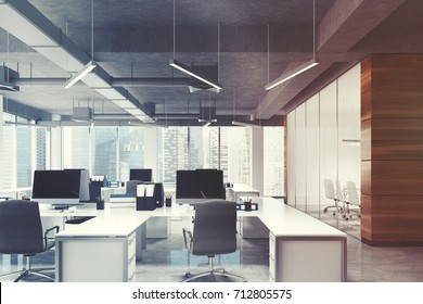 Open space office environment with dark wooden, white and glass walls, rows of white computer desks and original ceiling lamps. 3d rendering mock up toned image