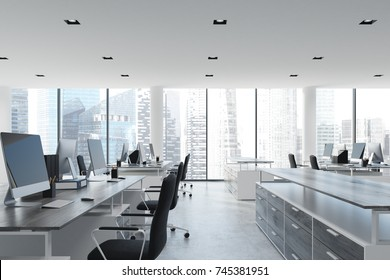 Open space office interior with white walls and ceiling, a concrete floor and panoramic windows. A row of computer desks with blank screens and bookshelves. Side view. 3d rendering mock up