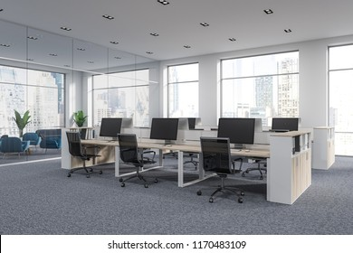 Open space office of a modern company with white walls, panoramic windows, gray carpet and rows of wooden computer tables. 3d rendering mock up