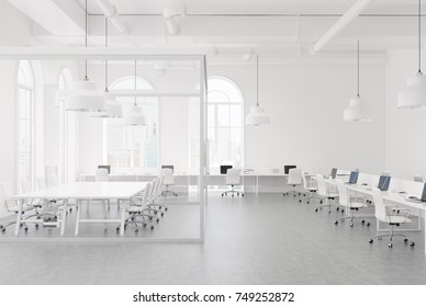 Open space office with white and glass walls, a concrete floor and arch windows. Rows of computer desks and a conference room. Side view. 3d rendering