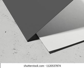Opened black leaflet and paper sheet on light grey concrete background, 3d rendering