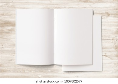 Opened and closed Portrait Magazines with blank pages and cover on wooden desk. 3d Illustration for your presentation.