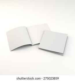 Opened and closed square format catalogs or magazines isolated