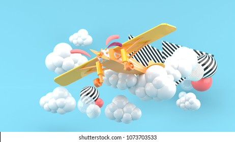 Orange airplane in the clouds on a blue background.-3d render.