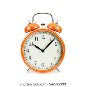 Orange alarm clock isolated on white background, 3D rendering