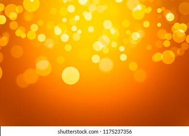 orange bokeh beautiful blurred bright light on abstract background. warm wallpaper. halloween concept. element for decoration or design advertising. soft glitter backdrop. defocused