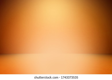 Orange bright painted concrete texture  Abstract Grunge Decorative Stucco wall background for the designer, Gold background yellow color light corner spotlight faint orange vintage background,