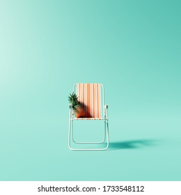 Orange chair with pineapple on pastel blue background. Summer minimal vacation concept. 3d rendering