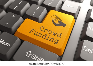 Orange Crowd Funding Button on Computer Keyboard. Internet Concept.