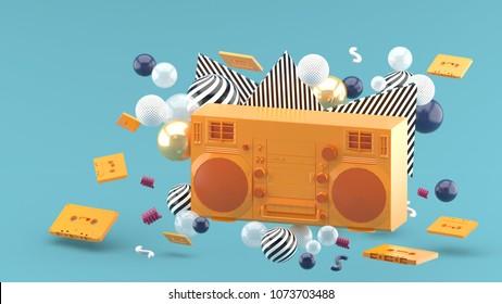Orange radio amidst colorful balls on a blue background.-3d render.