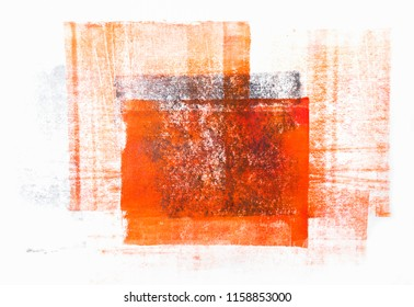 Orange-black acrylic paint rolled in abstract shape on white paper background